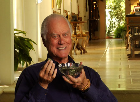 Larry Hagman, a.k.a. J.R. Ewing, with a small cup of algae, the possible future of biofuels.