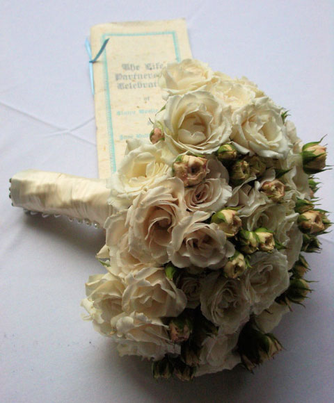 Bridal bouquet & wedding program.