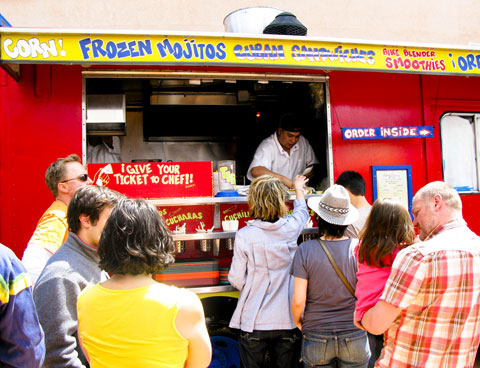 Kitchen on wheels: a red U.S. postal truck has been converted into an outdoor kitchen.