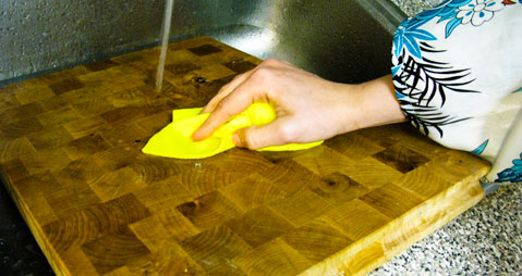 Clean cutting boards thoroughly with soap and water, put some power and baking soda into it to get rid of grime.