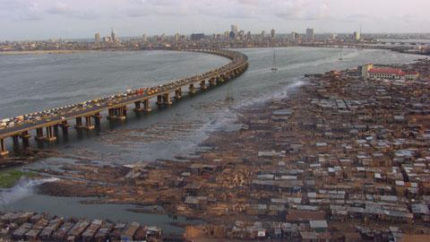 "Slums in Makoko opposite Lagos Island, Lagos, Nigeria (6°30' N - 3°24' E). © ""HOME"" – an ELZEVIR FILMS – EUROPACORP coproduction."