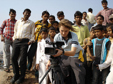 Director Franny Armstrong shooting in the Mumbai slums. This location was also later used in the film Slumdog Millionaire.