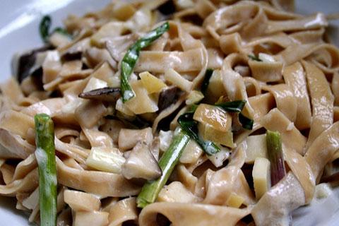 Al Dente mushroom fettuccine with green garlic and mushrooms.