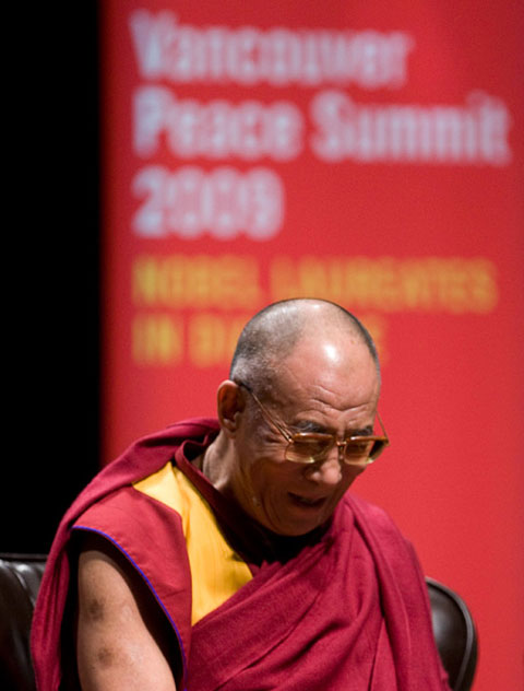 The Dalai Lama laughs as a feedback problem with the microphones persists prior to the start of the panel discussion. Photo: THE CANADIAN PRESS/Jonathan Hayward.