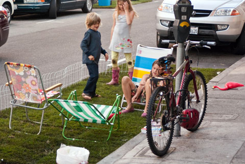 Children relax in PARK(ing) Day spot outside A-B Fits on Upper Grant in North Beach, SF. Photo by sfbike, Creative Commons.