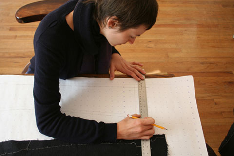Eliza Starbuck working on the pattern for the Uniform Project dress.