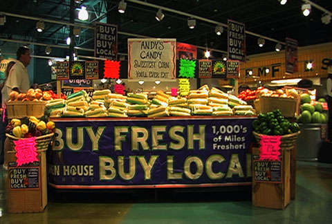 Informational signage in Ball's stores lets shoppers know where their food comes from, down to the name of the farmer.