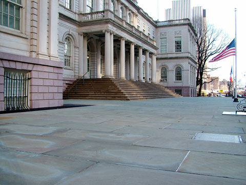 The outside of City Hall in its current state — a bleak stone landscape.