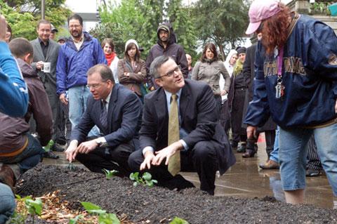 Mayor Sam Adams planting a garden outside City Hall in Portland, OR.