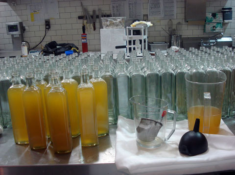 Each bottle is painstakingly filled, by hand, before being hand-sealed and labeled.
