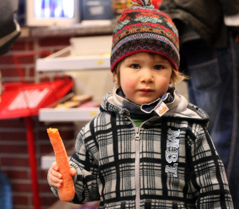 A carrot is always better than a stick. A young carrotmobber in Bremen, Germany. Photo by carrotmobbremen, Creative Commons.