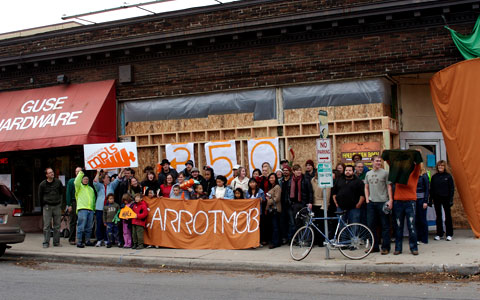 Carrotmobbers outside Guse Hardware in Minneapolis, MN. Photo by 350.org, Creative Commons.