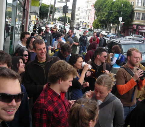 A large crowd formed outside K & D Market in San Francisco, for the first-ever Carrotmob. Photo by meganpru, Creative Commons.