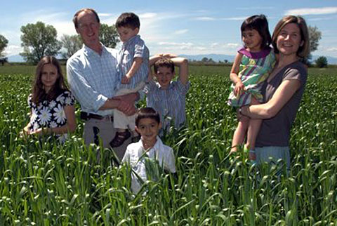Greg Massa and Raquel Krach of Massa Organics in the field with their children.
