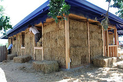 The family's house is built from rice straw bales.