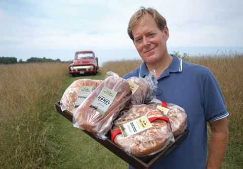 Brian Noyes with his baked goods, in front of the red truck he bought from Tommy Hilfiger.