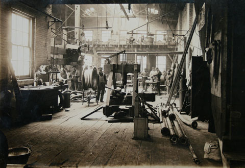 Kirsten's Great-Grandfather, Rudolph Muenster (standing on the far right), in the coppersmith shop in Newark, NJ 1939.