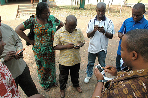 Field teams synchronize their mobile devices before traveling to clinics and households to gather vital health data. The mobile health program is organized by the UN Foundation and Vodafone Foundation, DataDyne.org, the UN World Health Organization and national Ministries of Health. Photo via DataDyne.org.