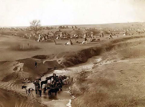 Photo of from 1891, Lakota Sioux Indian camp on River Brule near Pine Ridge, South Dakota. By John C. H. Grabill.