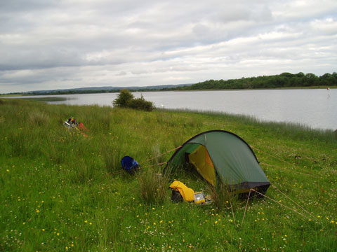 Just you, the tent and mother nature — freedom and tranquility. Here, a camp on Trannish Island, Upper Lough Erne, Northern Ireland. Photo by Steve Cadman, Creative Commons.