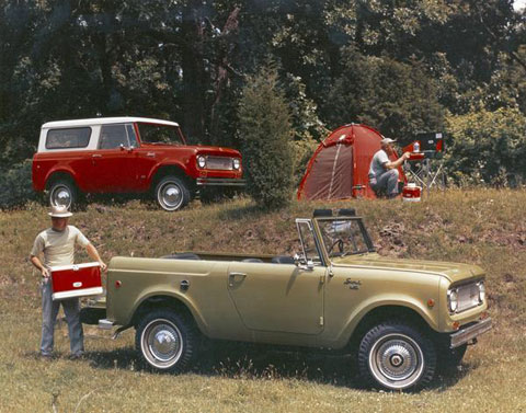 Advertising photograph of two men, with their 1972 International Scouts, setting up camp in a wooded area. Photo by Wisconsin Historical Images, Creative Commons.