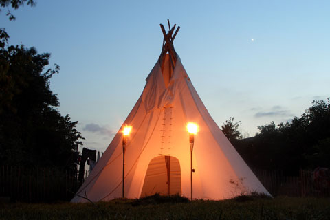 "If small tents are not your thing, try ""glamping"" in a luxe teepee! Photo by jamesmorton, Creative Commons."