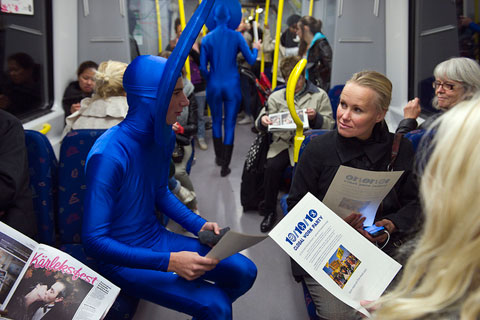 Stockholm, Sweden: Activists dressed up in sun, wind and water costumes thanked people in the subway for choosing public transport and invited them to participate in the other activities taking place at the central square. (Photo credit: © Aslund/Greenpeace)