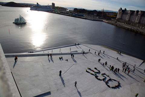 Oslo, Norway: After a bike race around the city, some activists relax outside the famous new Opera House.
