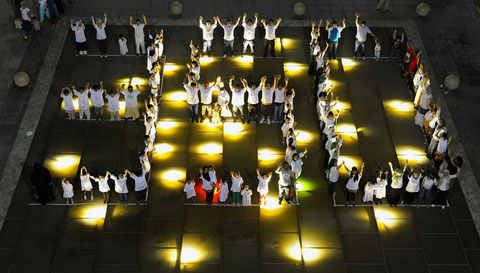 Sharjah, United Arab Emirates: Participants in a climate festival formed a giant 350.