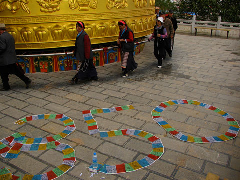 Shangri-La, China: Concerned citizens gathered at the temple to promote the spiritual connection to preserving the earth, its climate and its people, and spelled out '350' in prayer flags.