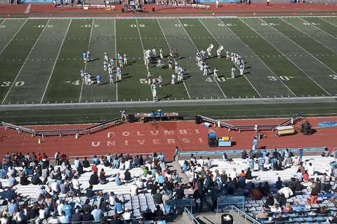 NYC, USA: The Columbia University Marching Band forms '350' on the field.