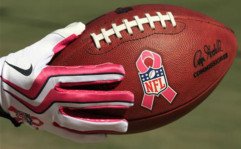 The National Football League shows it's commitment to breast cancer awareness on the field, and football players also wear pink gear.