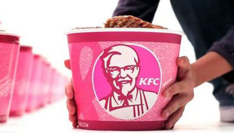 "While promoting breast cancer awareness with pink buckets, KFC also offers calorie and cholesterol bombs like their ""Double Down Sandwich."""