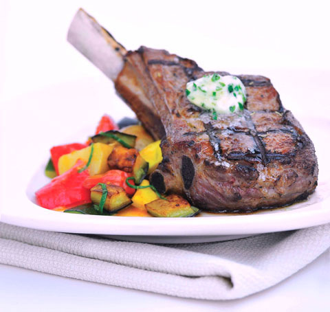 Strauss Free Raised Veal Chops with Ratatouille and Herb Butter, the recipe can be found on the company's website.