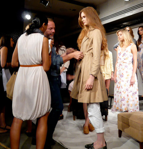 John Patrick putting final touches on models before a NYFW presentation of his Organic by John Patrick line. Photo by Abigail Doan for Ecco Eco.