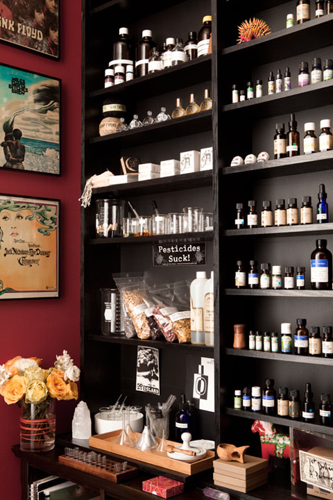 Essential oils fill the shelves in Amanda's studio. Photo by Payam.