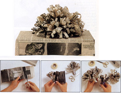 Newspaper-wrapped gift with matching newspaper flower on top. By Adelle.