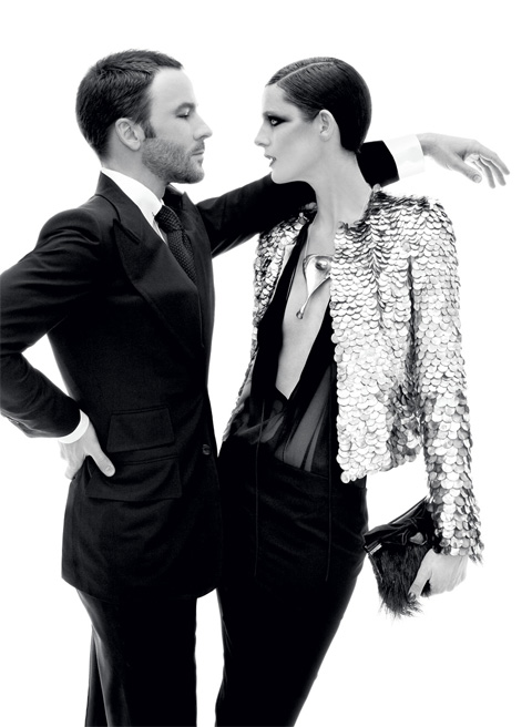 Ford pictured in Vogue with model Stella Tennant. Paillette jacket, sheer silk blouse, silk-georgette skirt, jewelry, and clutch; Tom Ford boutiques. Photo by Steven Meisel, via Vogue.
