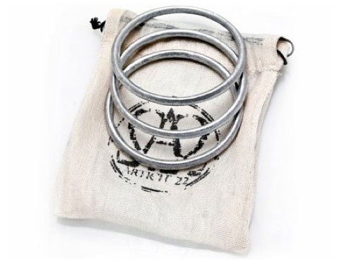 Each hand cast and finished single bangle or set comes with a handwoven organic cotton drawstring pouch and story card.
