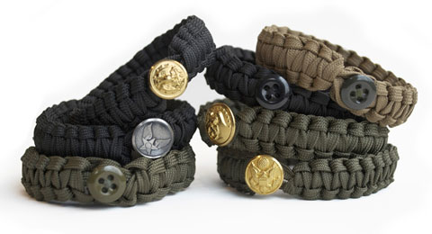 Peace Cords are hand woven in Afghanistan using 550 parachute cord and military uniform buttons.