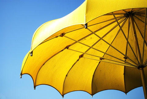 The best thing we can all do to protect ourselves from the sun is to stay in the shade in the middle of the day, when it's at it's strongest. Bring a pretty umbrella to the beach and give yourself a break from the rays every now and then.
