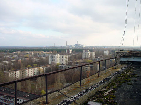 View of Chernobyl power plant taken from the roof of a building in Pripyat, Ukraine. Photo by Jason Minshull (Wikimedia Commons).