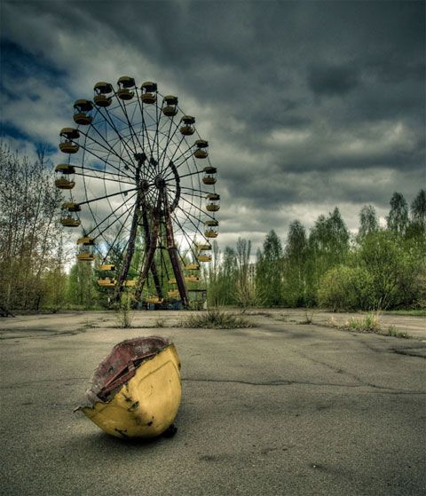 The Pripyat funfair was due to be opened on May 1st. The Chernobyl disaster happened April 26th, soo one ever managed to ride the ferries wheel. It remains one of the most irradiated parts of Pripyat since the disaster, making it still dangerous today. Photo by Vivo (Ben).
