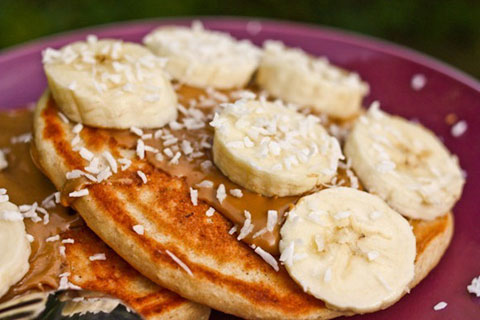 Kodiak cakes made with banana, flax, coconut and a sprinkle of sea salt. Via Katheats.com.