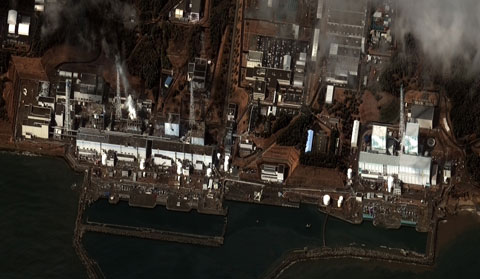 Satellite picture from March 16 showing the damage to reactor buildings one through four. Photo by DigitalGlobe.