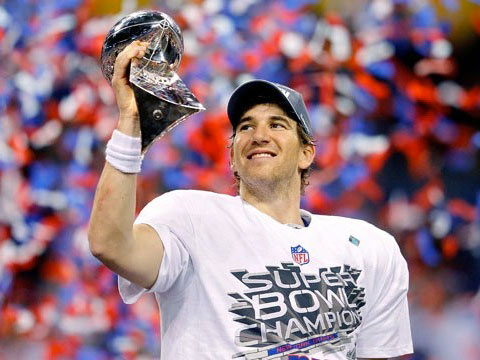 Just seconds after the end of Super Bowl XLVI Eli Manning and the Giants were sporting Championship gear.