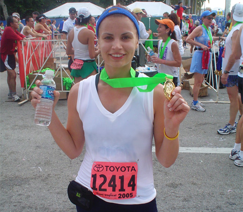 Yours truly, after finishing my second half marathon in 2005. (Please ignore the plastic water bottle, I was desperately thirsty and it was offered to me.)
