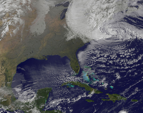 NOAA's GOES-13 satellite captured this visible image of Hurricane Sandy battering the U.S. East coast on Monday, Oct. 29 at 9:10 a.m. EDT. The image was created by the NASA GOES Project at NASA's Goddard Space Flight Center, Greenbelt, MD.