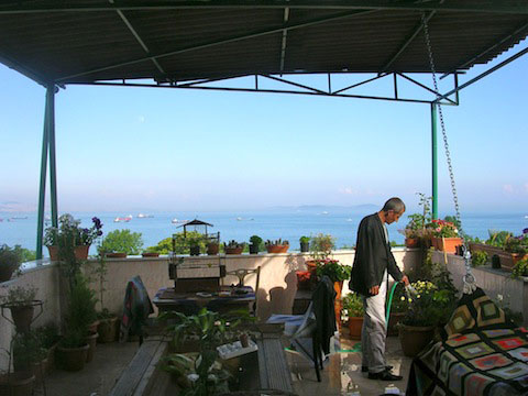 Abit Bayar tends to the terrace garden with gorgeous views out over the waters of Istanbul