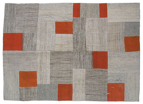 Bazaar Bayar's vintage repurposed patchwork kilim in natural shades with shots of vibrant overdyed orange.